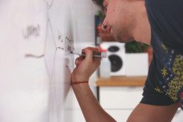 Employee Designing a Business Process on a Whiteboard